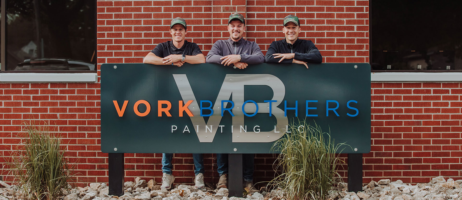 Vork Brothers standing by Vork Brothers Painting office sign
