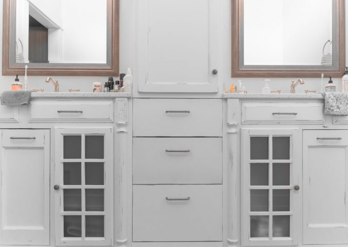 Repainted white bathroom cabinets in a Holland residential home